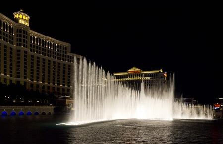 caesars palace: LAS VEGAS, USA - AUGUST 5: Bellagio waterworks, beautiful water games at night in front of the Bellagio Hotel facing Caesars Palace in Las Vegas, on August 5 2013