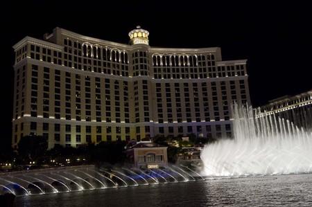 caesars palace: LAS VEGAS, USA - AUGUST 5: Bellagio waterworks, beautiful water games at night in front of the Bellagio Hotel in Las Vegas, on August 5 2013