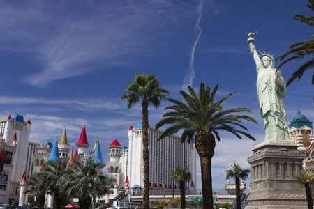 new york strip: LAS VEGAS, USA - AUG 5: Day view of Las Vegas Strip, with all its modern building in a sunny day, and the copy of the New York Statue of Liberty, on August 5 2013 Editorial