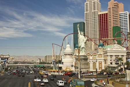 new york strip: LAS VEGAS, USA - AUG 5: Day view of Las Vegas Strip, with all its modern building in a sunny day, With Statue of Liberty and road with traffic on on August 5 2013