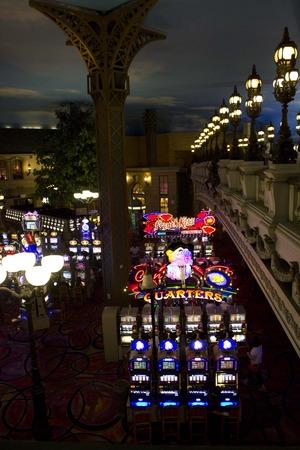 slot machines: LAS VEGAS, USA - AUG 6: Inside the Paris Casino in Las Vegas, view of the slot machines at night on August 6 2013 Editorial
