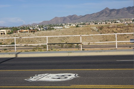 ARIZONA, USA - AUGUST 8 2013: Historic Route 66 road in Arizona, with nobody around in a sunny day, and the script on the concrete photo
