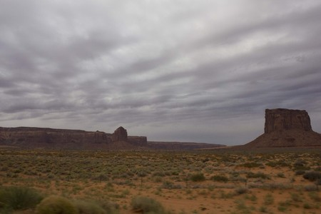 dismal: ARIZONA, USA - AUGUST 7: The scenic road to Monument Valley before dawn in a dull and foggy day, onAugust 7 2013 Stock Photo