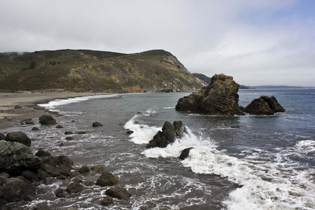 muir: MUIR BEACH, USA - AUG 12 2013: Muir Beach, located 16.5 miles northwest of San Francisco in western Marin County, California, a pacific landscape through Pacific Ocean Stock Photo