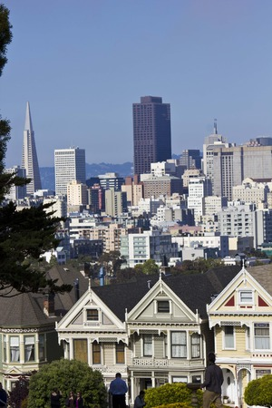 SAN FRANCISCO, USA - AUG 13 2013: Alamo square and the Painted Ladies Victorian houses  in San Francisco, with city skyline in the background Editorial