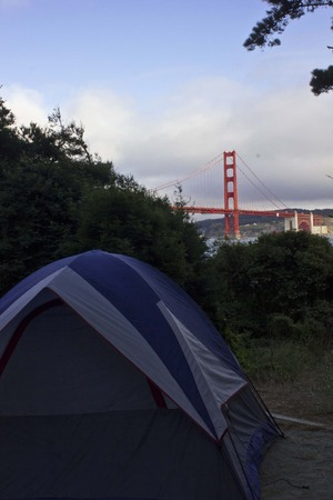campground: SAN FRANCISCO, USA - AUG 11 2013: A tent overlooking the Golden Gate bridge in Kirby Cove campground in San Francisco