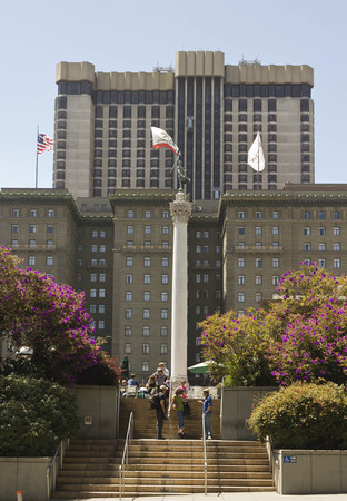 dewey: SAN FRANCISCO, USA - AUG 12 2013: Union Square in downtown San Francisco, view of the  Westin St Francis hotel in the background and the Dewey Monument in the centre of the Square Editorial