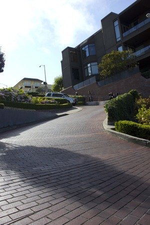 switchback: SAN FRANCISCO, USA - AUG 11 2013: The famous Lombard Street in San Francisco, famous for its steep, one-block section with eight hairpin turns, with a jeep crossing it. Editorial