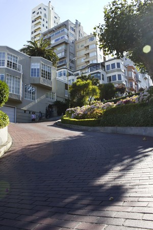switchback: SAN FRANCISCO, USA - AUG 11 2013: The famous Lombard Street in San Francisco, famous for its steep, one-block section with eight hairpin turns.