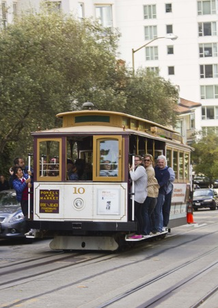 hang out: SAN FRANCISCO, USA - AUG 11 2013: Person hang out of a  traditional tram in San Francisco