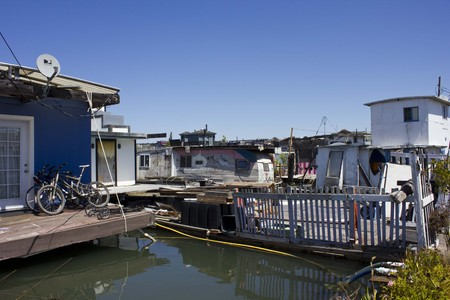 house float on water: SAN FRANCISCO, USA - AUG 11 2013: Sausalito houseboats, in the San Francisco Bay Area, picturesque residential community
