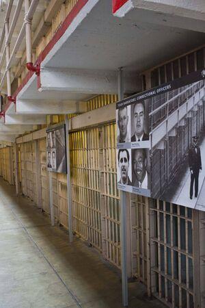 narrator: ALCATRAZ, USA - AUGUST 12 2013: History of Alacatraz through photo hang at the cells Editorial