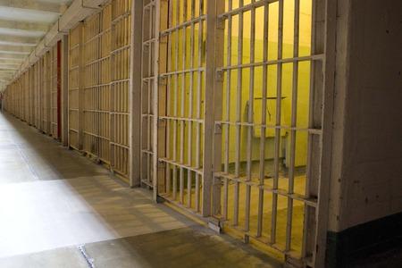 jailhouse: ALCATRAZ, USA - AUGUST 12 2013: Prison Corridor inside the Alcatraz Penitentiary, with the row of rooms Editorial