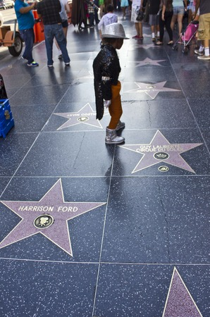 michael jackson: LOS ANGELES, USA - AUGUST 17 2013: A young boy performing Michael Jackson on Hollywood Walk of Fame