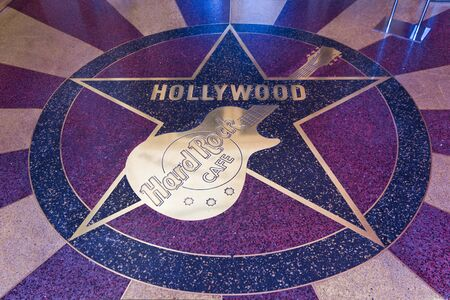 hard rock: LOS ANGELES, CALIFORNIA - AUG 16 2013: Hard Rock Cafè logo on the floor, inside the Universal Studios Editorial