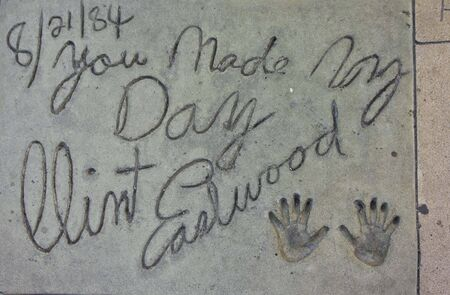 autograph: LOS ANGELES, USA - AUG 17 2013: Clint Eastwood handprints along the Walk of Fame in Los Angeles Editorial