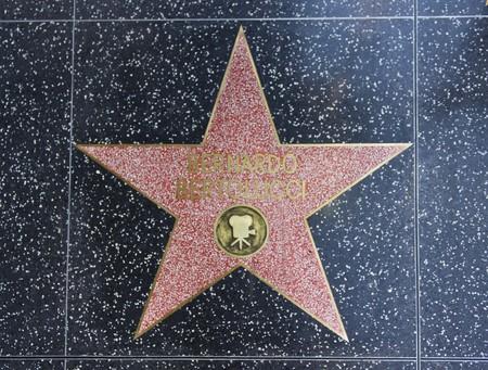 walk of fame: LOS ANGELES, USA - AUG 17 2013: Hollywood Walk of Fame, Bernardo Bertolucci star on the floor