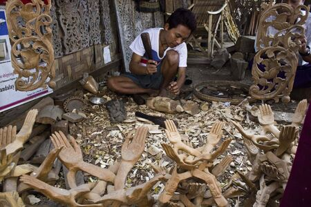 craftman: Myanmar, March 2014: Burmese Artisan works wood. mage take in a little village in the region of Mandalay (burma, Myanmar). A craftman was workinh on wood sculpture. Wood carving traditional is related with Myanmar cultural of Jataka (Buddhist historical l