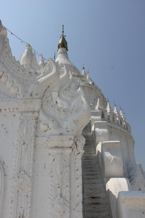 Mingun, Myanmar - March 2014: Hsinbyume or Myatheindan pagoda in Mingun, is a beautiful white Pagoda with a distinctive architectural style modelled after the mythical Mount Meru. It is dedicated to the memory of his first consort Princess Hsinbyume.