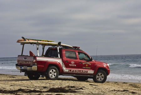 rescuer: SAN DIEGO, USA - AUGUST 20 103: Toyota Lifeguard vehicle at sunset on Mission Bay Beach in San Diego, California