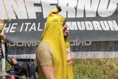 costum: SIGNA, ITALY - MAY 9 2015: Man dressed as a banana during the mud race competition near Florence, all dirt by mud Editorial