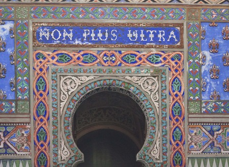 fret: REGGELLO, ITALY - MAY 2 2015: Sammezzano Ancient Castle interior. Close up of the doorway with the text Non Plus Ultra Editorial