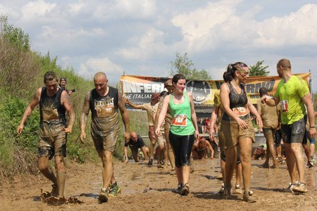 muddy clothes: SIGNA, ITALY - MAY 9 2015: People dirt with mud during a Mud Run competition in Italy Editorial