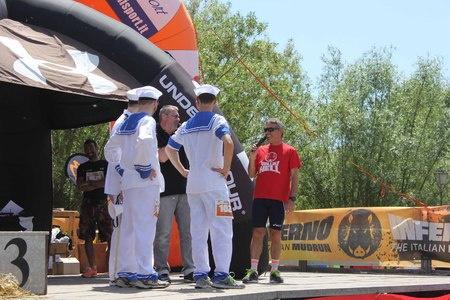 dais: SIGNA, ITALY - MAY 9 2015: Team of a running competition funny dressed as sailors, on the stage before the beggining of the competition, near Florence, Italy