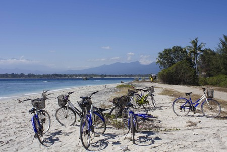 white sand: Group of bicycles parked on the White Sand of Gili Islands, Indonesia Editorial