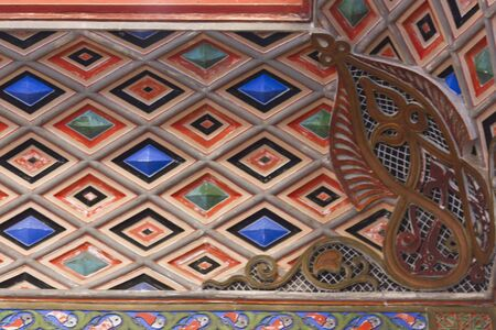fret: REGGELLO, ITALY - MAY 2 2015:The beautiful ceiling at the entrance of Sammezzano Castle in Tuscany, Italy, typical of Orientalism style. Close up detail