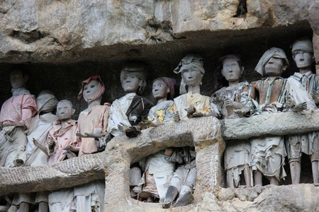 representing: Close up of the burial site of Suaya, with Traditional Tau tau, wooden statues representing dead men Stock Photo