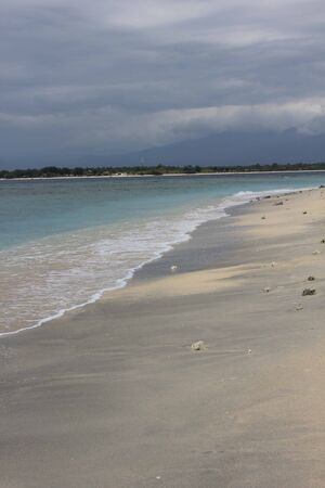 foreshore: Tropical Indonesian Gili Islands beach waters edge in a dull day