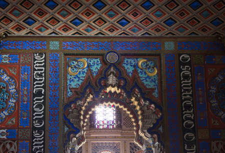 fret: REGGELLO, ITALY - MAY 2 2015: Sammezzano Ancient Castle interior. Close up of the doorway with a text Editorial