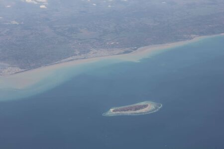 atoll: View from the airplane of Bali and a little atoll in the sea Stock Photo