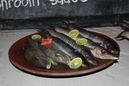fish plate: Fish plate served with lemon in Indonesia