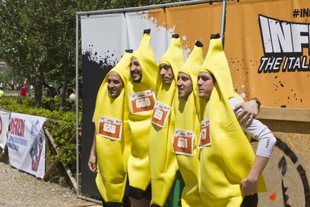 inferno: SIGNA, ITALY - MAY 9 2015: Participant at Inferno Run 2015 near Florence, funny dressed as bananas. Group photo before the beginning