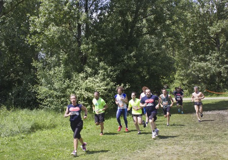 inferno: SIGNA, ITALY - MAY 9 2015: Group of people running in the Renai Park near Florence during the Inferno Run competition