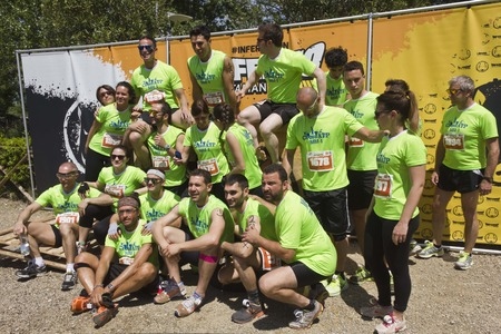 participant: SIGNA, ITALY - MAY 9 2015: Participant at Inferno Run 2015 near Florence, all dressed the same Editorial