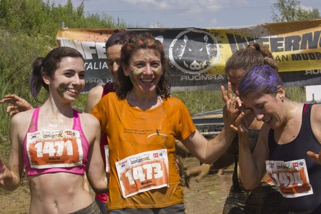 mud pit: SIGNA, ITALY - MAY 9 2015: Women smiling after the mud run competition near Florence