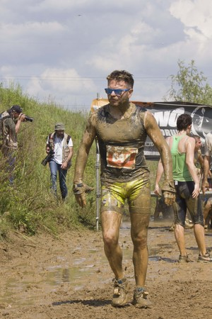 mire: SIGNA, ITALY - MAY 9 2015: Portrait of a man dirt with mud during a Mud Run competition in Italy Editorial