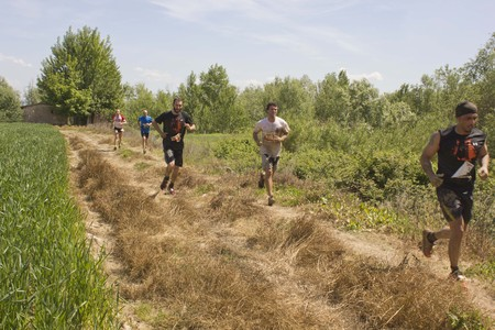 inferno: SIGNA, ITALY - MAY 9 2015: Group of people running outdoor in a field in Tuscany, during the Inferno Run competition