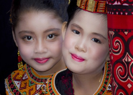 celebes: TANA TORAJA, INDONESIA - JULY 4 2012: Portrait of two beautiful Torajan girls at a funeral ceremony Editorial