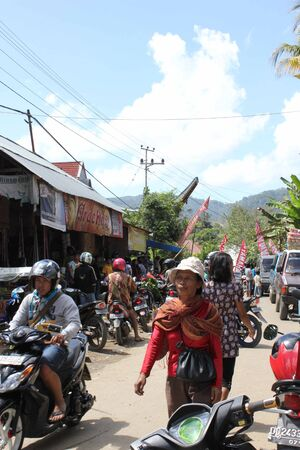 celebes: TANA TORAJA, INDONESIA - JULY 4 2012: People along the street of a little rural village in Tana Toraja, Indonesia, with its local market Editorial