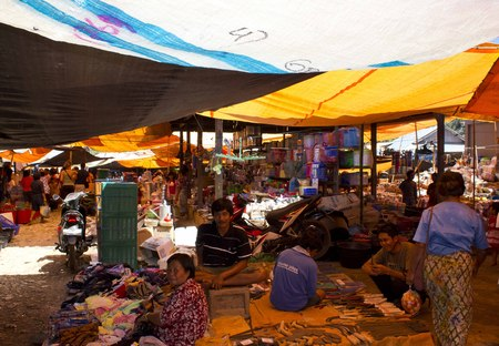 celebes: SULAWESI, INDONESIA - JULY 4 2012: Traditional street market in Indonesia, with people selling food or dress