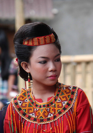 indonesia girl: TANA TORAJA, INDONESIA - JULY 3 2012: Portrait of a beautiful young Torajan girl during a funeral ceremony indonesia Editorial