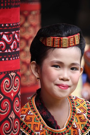 funeral: TANA TORAJA, INDONESIA - JULY 4 2012: Portrait of a beautiful Torajan girl at a funeral ceremony