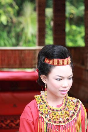 toraja: TANA TORAJA, INDONESIA - JULY 3 2012: Portrait of a beautiful young Torajan girl during a funeral ceremony indonesia Editorial