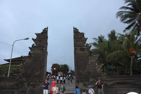 entrance gate: BALI, INDONESIA - JULY 12 2012: Entrance gate of Tanah Lot Temple in Bali, with people around