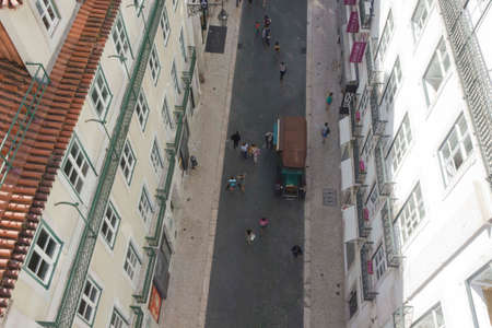 carmo: LISBON, PORTUGAL - OCTOBER 25 2014: View from the top of  Santa Justa elevator of Rua do Carmo shopping street in Lisbon, with people walking along the street