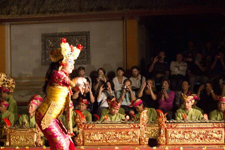 traditional dance: BALI, INDONESIA - JULY 6 2012: Balinese traditional dance, In Ubud, Bali, with tourists watching it Editorial